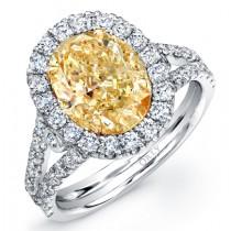 OVAL YELLOW DIAMOND WITH DIAMOND HALO AND SPLIT SHANK